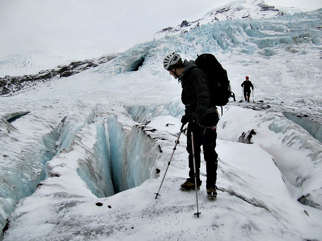 A climber looks at crevasses