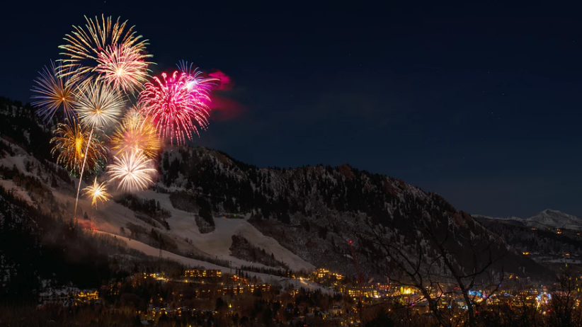New Year's Eve fireworks explore over soaring mountain peaks